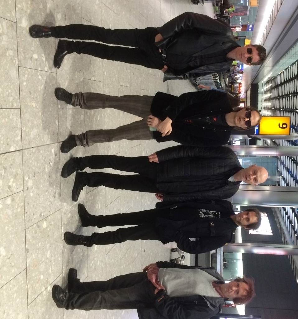 """The classic """"tired band at an airport"""" photograph."""