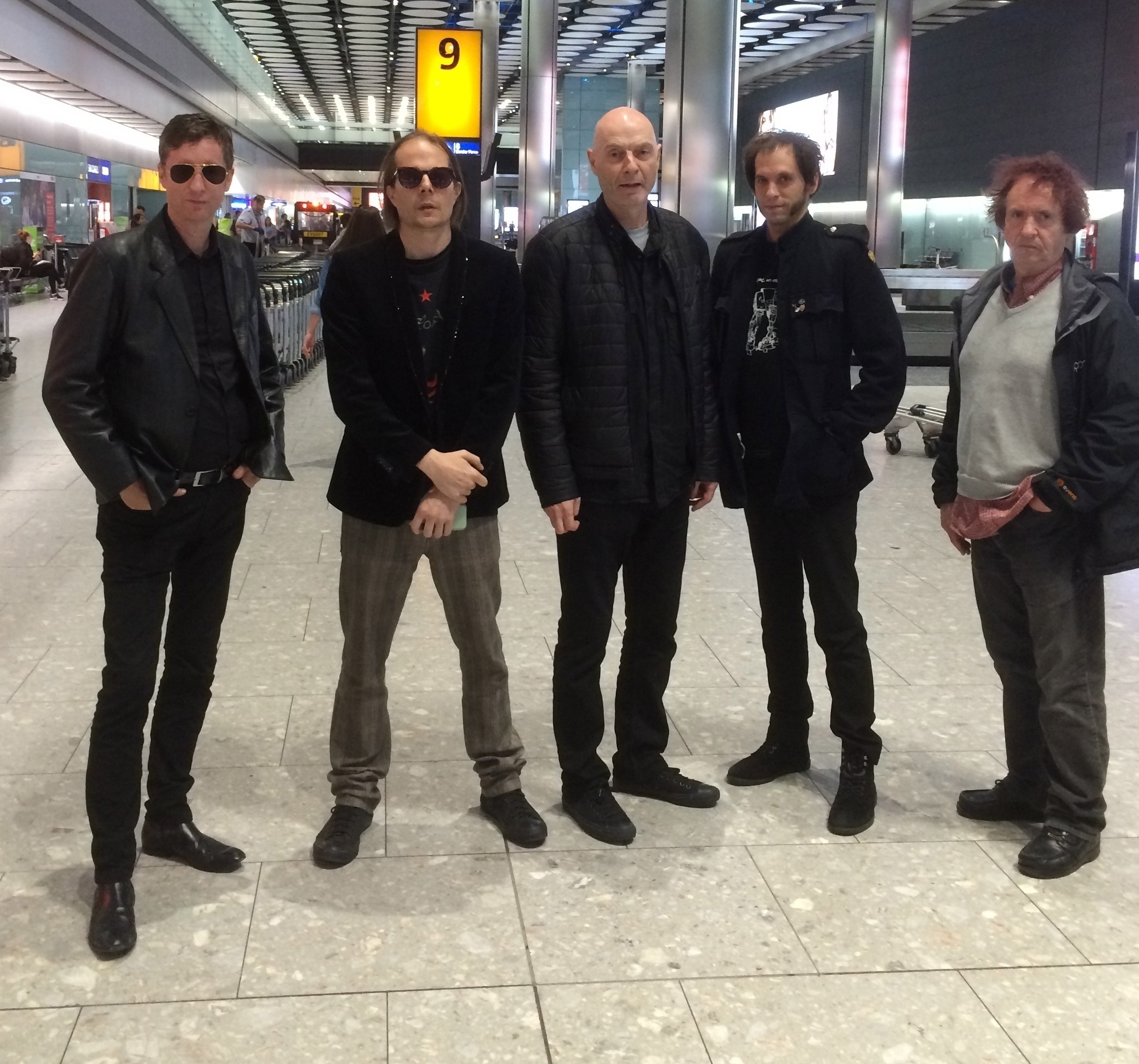 "The classic ""tired band at an airport"" photograph."